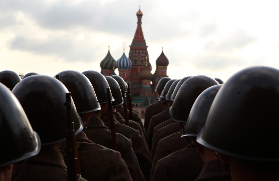 Russian servicemen, dressed in historical uniform, take part in a military parade rehearsal in Red Square in Moscow