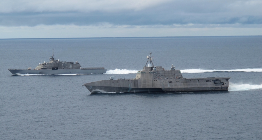120502-N-ZZ999-009 SAN DIEGO (May 2, 2012) The first of class littoral combat ships USS Freedom (LCS 1), left, and USS Independence (LCS 2), maneuver together during an exercise off the coast of Southern California. The littoral combat ship is a fast, agile, networked surface combatant designed to operate in the near-shore environment, while capable of open-ocean tasking, and win against 21st-century coastal threats such as submarines, mines, and swarming small craft. (U.S. Navy photo by Lt. Jan Shultis/Released)